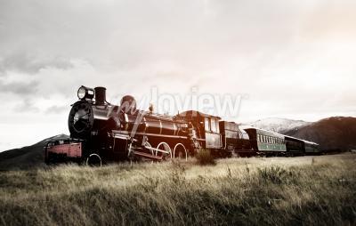 Fotomural Tren de vapor en un campo abierto concepto de transporte
