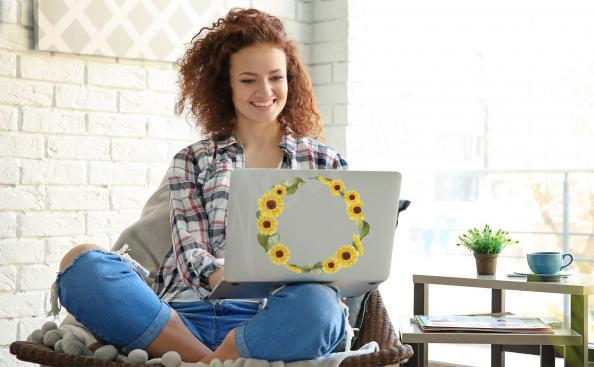 Vinilo girasol en la computadora portátil